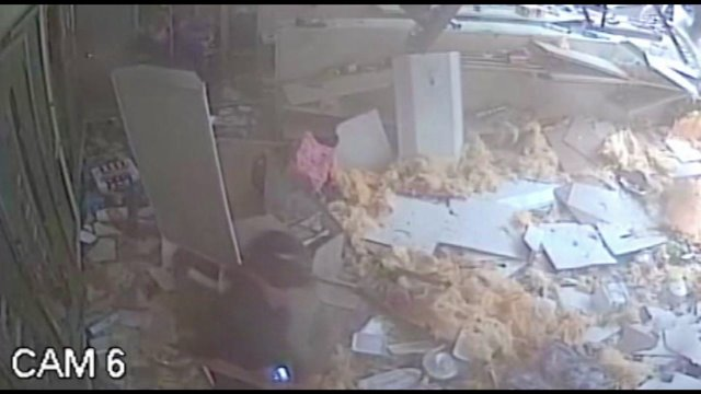 Surveillance video shows store destroyed by tornado