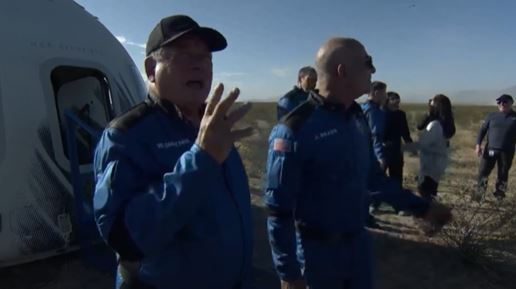 William Shatner with Blue Origin founder Jeff Bezos talking after successful landing. KIAH